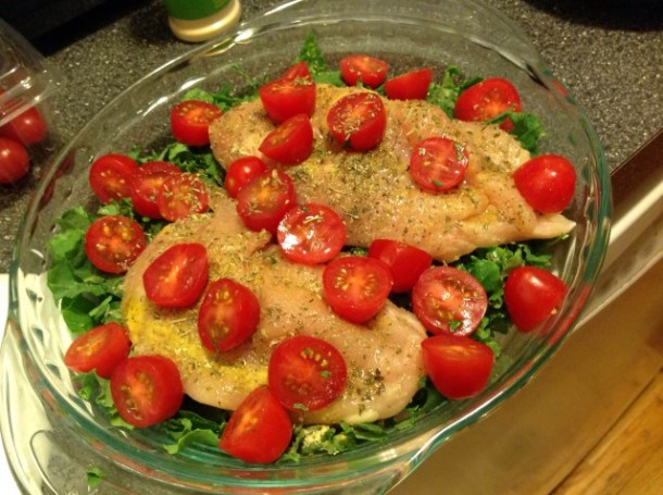 Raw chicken and kale tomatoes