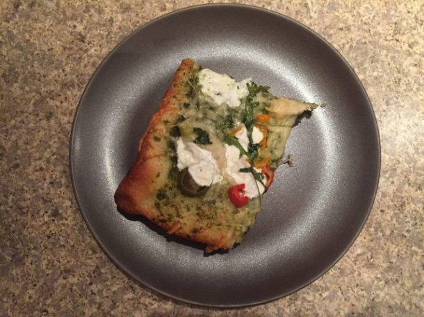 Slice of pesto pizza